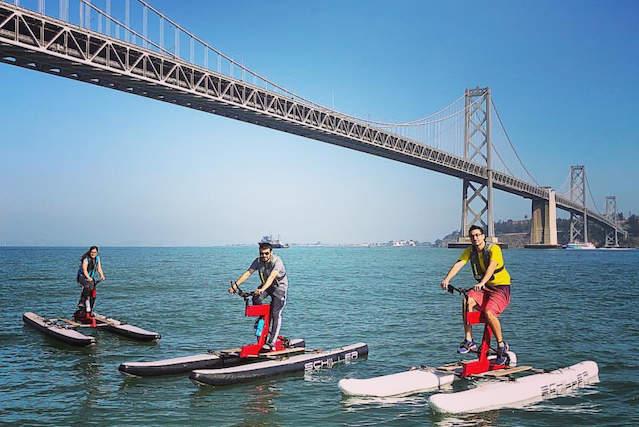 people enjoying water bikes on san francisco bay